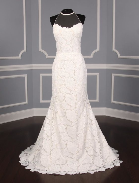 This Isabelle Armstrong Georgia X wedding dress is Brand New!  The gown is made from luxurious off white (light ivory) lace.  It has a sheer illusion halter neck with a low back, trumpet silhouette and a sweep train.  This Isabelle Armstrong wedding gown is extremely elegant and perfect for any type of wedding venue.